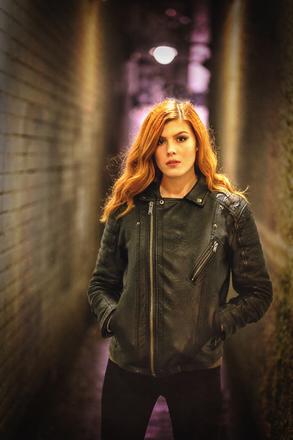 Enya in leather jacket in alley at night